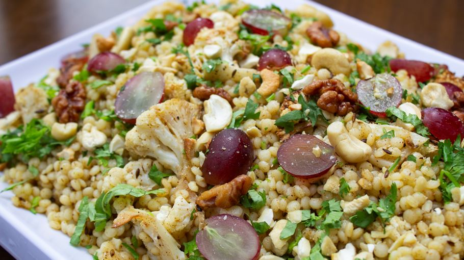 Cauliflower and Israeli couscous with cumin, grape and nuts (V) / (VE)